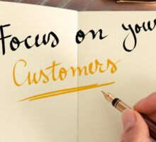 Handwritten text Focus On Your Customers Sticker