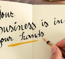 Handwritten text YOUR BUSINESS IS IN YOUR HANDS Sticker