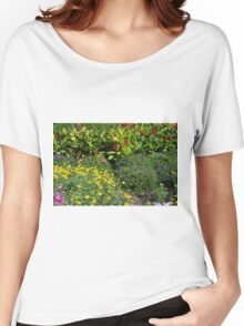 Many colorful flowers in the garden. Women's Relaxed Fit T-Shirt