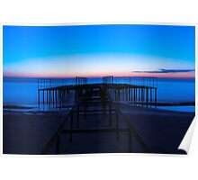 Abstract construction on the shore of the blue sea at dawn Poster