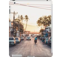 Sun sets in the village iPad Case/Skin