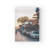 Sun sets in the village Hardcover Journal