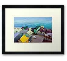 Many color houses on the coast of the sea Framed Print