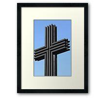 black iron cross on a sky background Framed Print