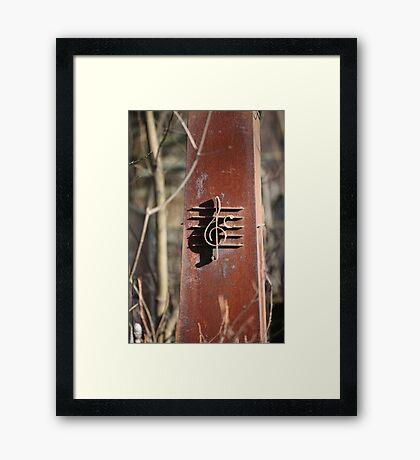 Iron treble clef Framed Print