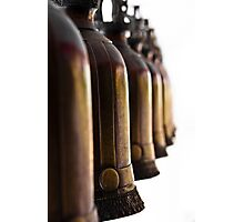 Bronze bells hang Photographic Print