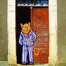Cat In Pyjamas in Doorway. Humor. by Mary Taylor