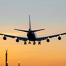Aircraft Landing at Sunset by derekbeattie