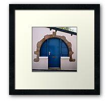 Blue door in circular stone arch Framed Print