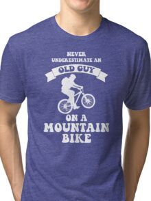 Never underestimate an old guy on a mountain bike Tri-blend T-Shirt