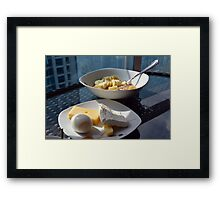 A bowl of cereals and yogurt and a plate with cheese and eggs. Framed Print
