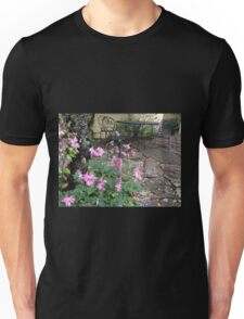 courtyard with black seats and pink flowers Unisex T-Shirt