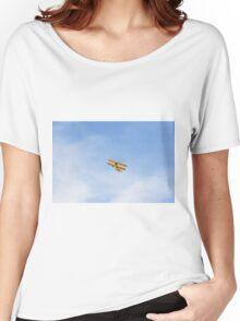 Single Engine Trainer Boeing Stearman PT-27 Kadet flying overhead. Women's Relaxed Fit T-Shirt