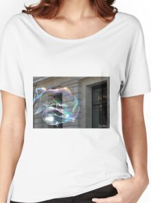 Colorful water bubble in front of classical facade building. Women's Relaxed Fit T-Shirt