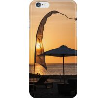 Flag and umbrella on beach in Bali at sunset. iPhone Case/Skin