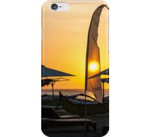 Flags and umbrellas on beach in Bali at sunset. iPhone Case/Skin