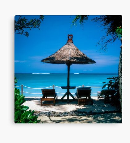 Beach umbrella and recliners, Bali, Indonesia. Canvas Print