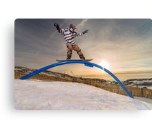 Snowboarder sliding on a rail Metal Print