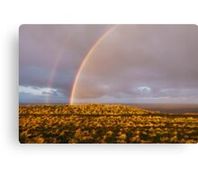 Rainbow and stormy sky at sunset. Sheringham, Norfolk, UK. Canvas Print