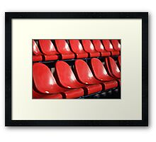 Red chairs bleachers Framed Print