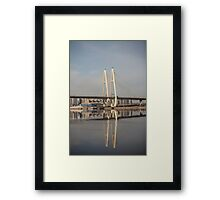 cable-stayed bridge reflected in the river Framed Print