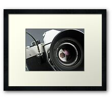 Camera in action. Framed Print