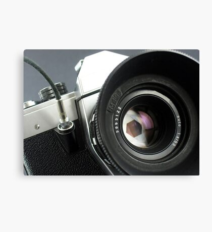 Camera in action. Canvas Print