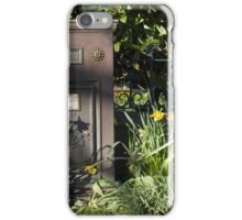 Vintage Royal Mail box surrounded by daffodils iPhone Case/Skin