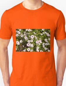 White spring flowers in the park. Unisex T-Shirt