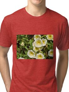 Yellow light flowers in the park. Tri-blend T-Shirt
