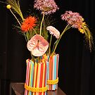 Flowers in a vase of straws by Arie Koene