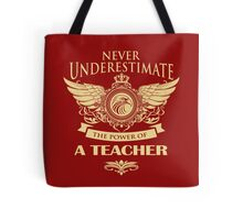 Never underestimate the power of a teacher Tote Bag