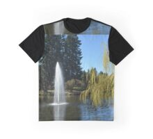 Beautiful spring garden with willow tree by a pond and water fountain Graphic T-Shirt