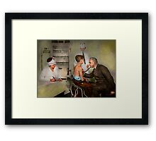 Doctor - At the pediatricians office 1925 Framed Print
