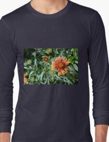 Orange flower and green leaves background. Long Sleeve T-Shirt