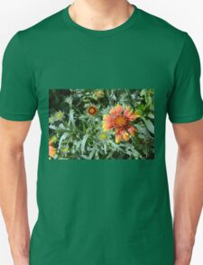 Orange flower and green leaves background. Unisex T-Shirt