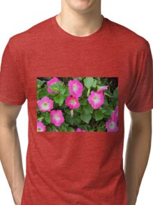 Purple flowers, natural background. Tri-blend T-Shirt