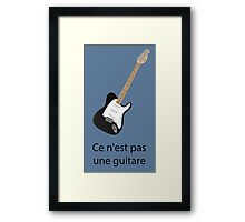 Ce n'est pas une guitare Framed Print