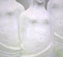 Three stone sculptures of women. Sticker