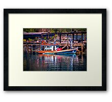 A boats and its reflection Framed Print