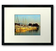 Greek sailing boats Framed Print