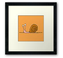 Funny snail with silly face expression Framed Print