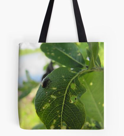 The beetle has destroyed the beauty of the blade Tote Bag