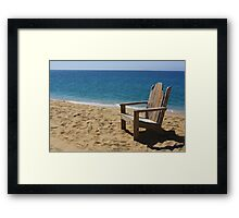 Empty weathered beach chair. Framed Print