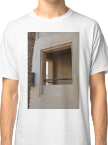 Window on beige wall. Classic T-Shirt