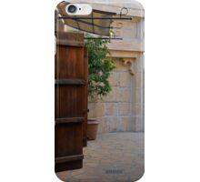 Medieval courtyard with wooden door. iPhone Case/Skin
