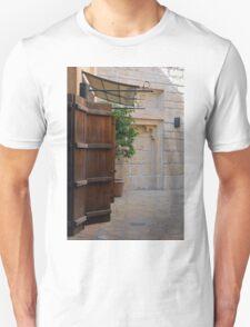 Medieval courtyard with wooden door. Unisex T-Shirt