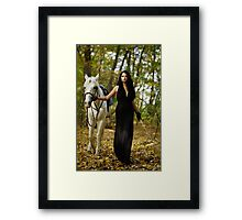 Woman with horse in the forest Framed Print
