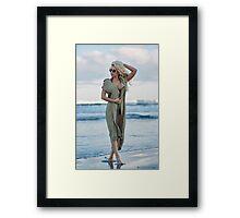 Beautiful woman on the sea shore Framed Print