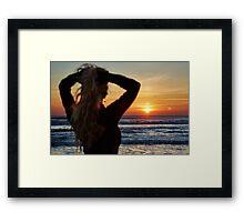 Beautiful woman on the beach at sunrise Framed Print